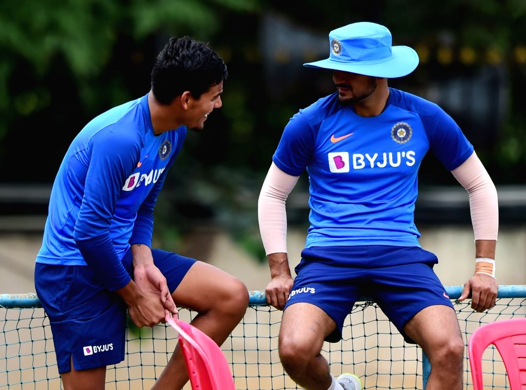 India's Rahul Chahar and Manish Pandey during a practice session ahead of the 3rd T20 match against South Africa at Chinnaswamy Stadium, in Bengaluru on Sep 20, 2019. - Manish Pandey