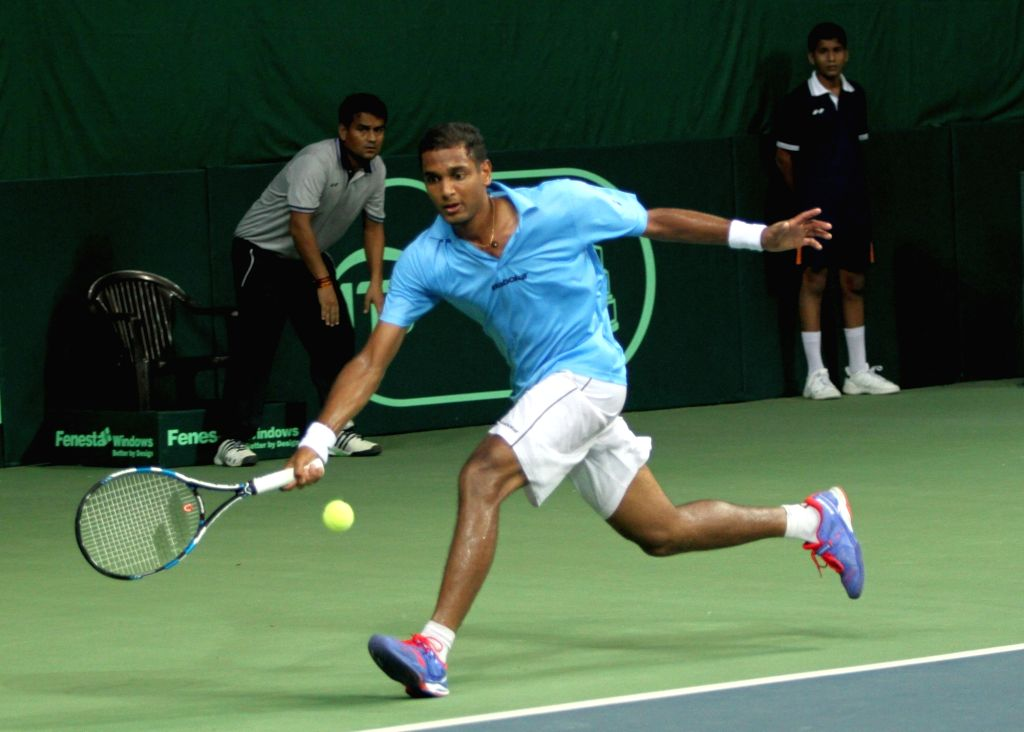 India's Ramkumar Ramanathan in action against Spain's David Ferrer during Davis Cup World Group Play-off match at RK Khanna Tennis Stadium in New Delhi on Sept 18, 2016. Spain won.