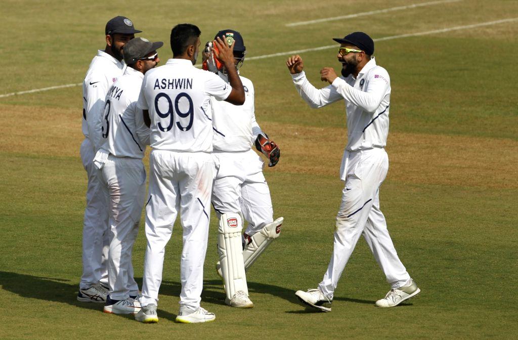 India's Ravichandran Ashwin celebrates fall of Mahmudullah's wicket on Day 1 of the 1st Test match between India and Bangladesh at Holkar Cricket Stadium in Indore, Madhya Pradesh on Nov 14, ...