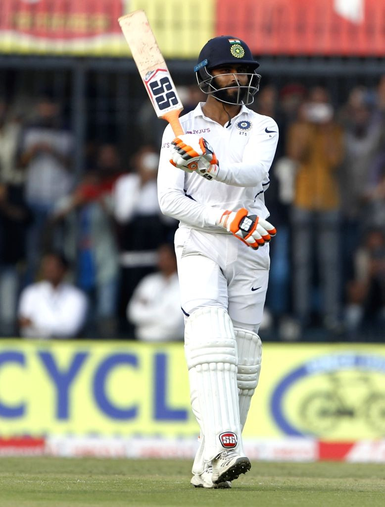 India's Ravindra Jadeja celebrates his half century on Day 2 of the 1st Test match between India and Bangladesh at Holkar Cricket Stadium in Indore, Madhya Pradesh on Nov 15, 2019. - Ravindra Jadeja