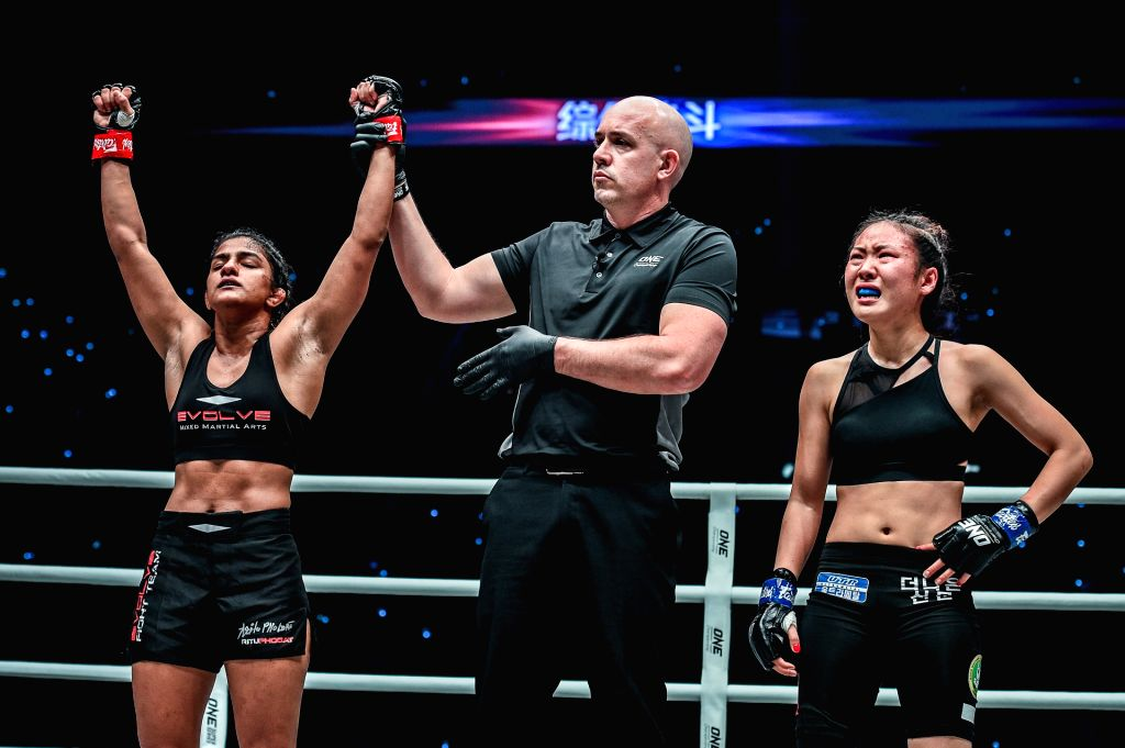 India's Ritu Phogat, who made her debut in mixed martial arts (MMA), celebrates after winning against South Africa's Kim Nam-hee at One Championship's Age of Dragons in Beijing on Nov 16, ...