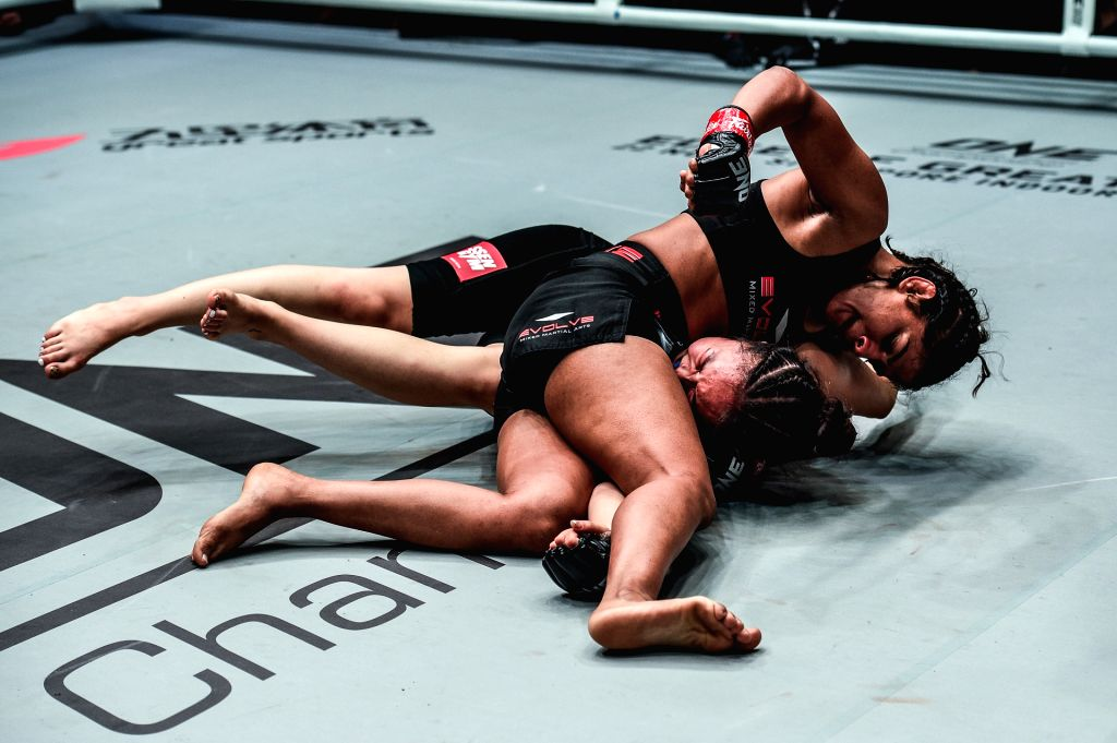 India's Ritu Phogat, who made her debut in mixed martial arts (MMA), in action against South Africa's Kim Nam-hee at One Championship's Age of Dragons in Beijing on Nov 16, 2019.