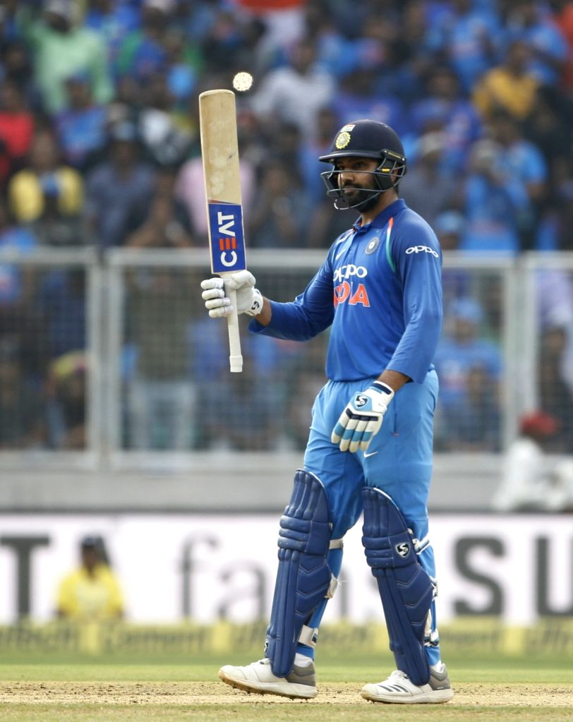 India's Rohit Sharma celebrates his half century during the fifth and final ODI match between India and West Indies in Thiruvananthapuram, on Nov. 1, 2018. - Rohit Sharma