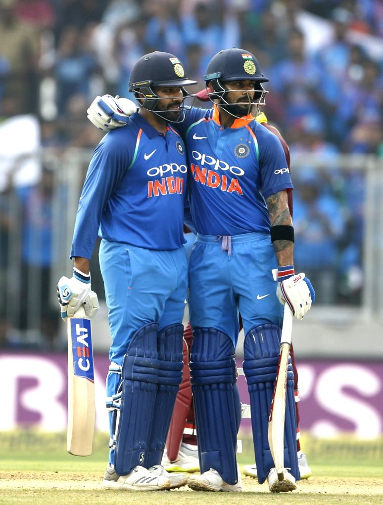India's Rohit Sharma celebrates his half century along with skipper Virat Kohli during the fifth and final ODI match between India and West Indies in Thiruvananthapuram, on Nov. ... - Rohit Sharma and Virat Kohli