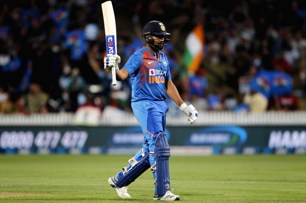 India's Rohit Sharma celebrates his half century during the third T20I of the five-match rubber at Seddon Park in Hamilton, New Zealand on Jan 29, 2020. - Rohit Sharma
