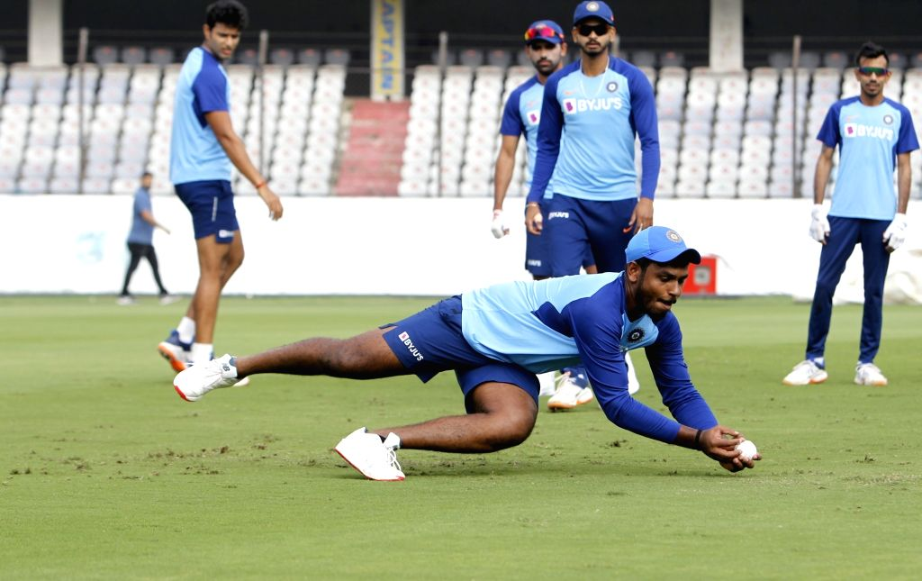 India's Rohit Sharma, Shreyas Iyer, Yuzvendra Chahal and Sanju Samson during a practice session ahead of the first Twenty20 match between India and West Indies at Rajiv Gandhi ... - Rohit Sharma