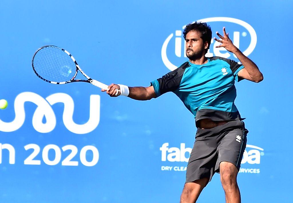 India's Saketh Myneni in action during a Bengaluru Tennis Open 2020 match at Karnataka State Lawn Tennis Association tennis court in Bengaluru on Feb 10, 2020.