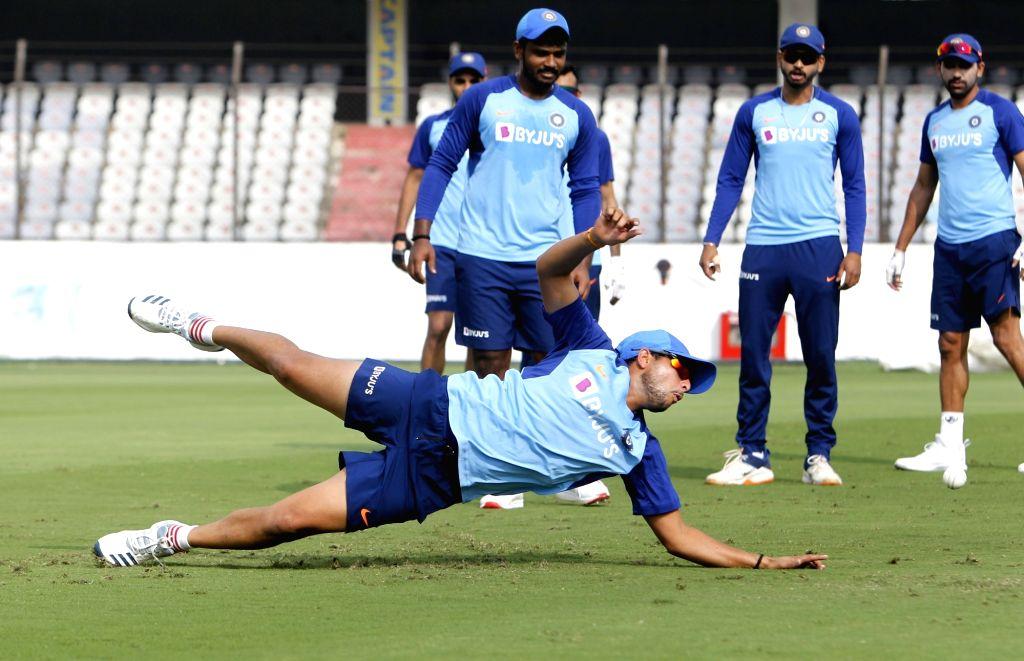India's Sanju Samson, Shreyas Iyer, Rohit Sharma and Kuldeep Yadav during a practice session ahead of the first Twenty20 match between India and West Indies at Rajiv Gandhi International ... - Rohit Sharma and Kuldeep Yadav