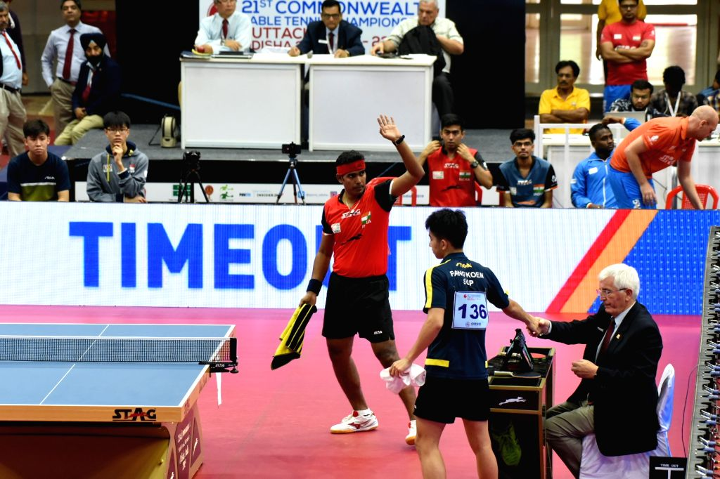 India's Sharath Kamal in action against Singapore's Koen Pang in the men's semifinal match at the 21st Commonwealth Table Tennis Championship at Jawaharlal Nehru Indoor Stadium in Odisha's ...