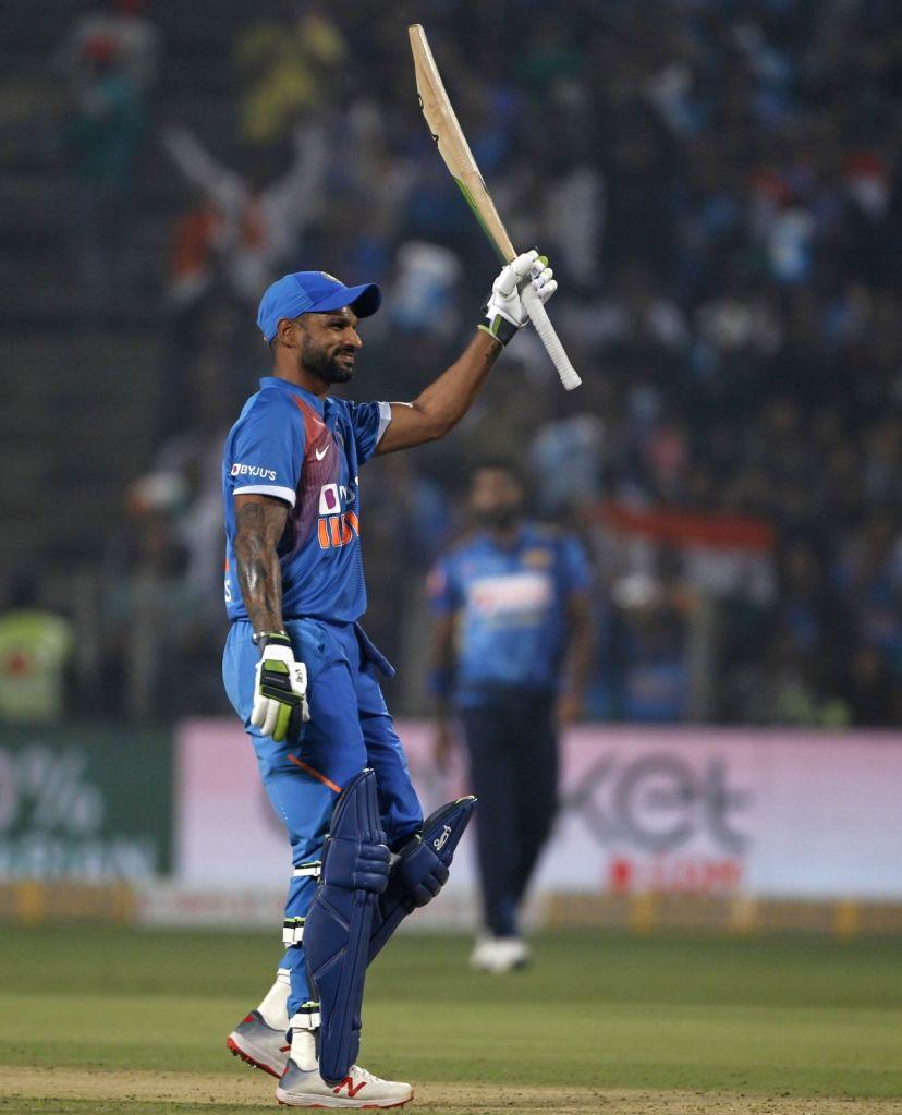 India's Shikhar Dhawan celebrates his half century during the 3rd T20I match between India and Sri Lanka at the Maharashtra Cricket Association Stadium in Pune on Jan 10, 2020. - Shikhar Dhawan