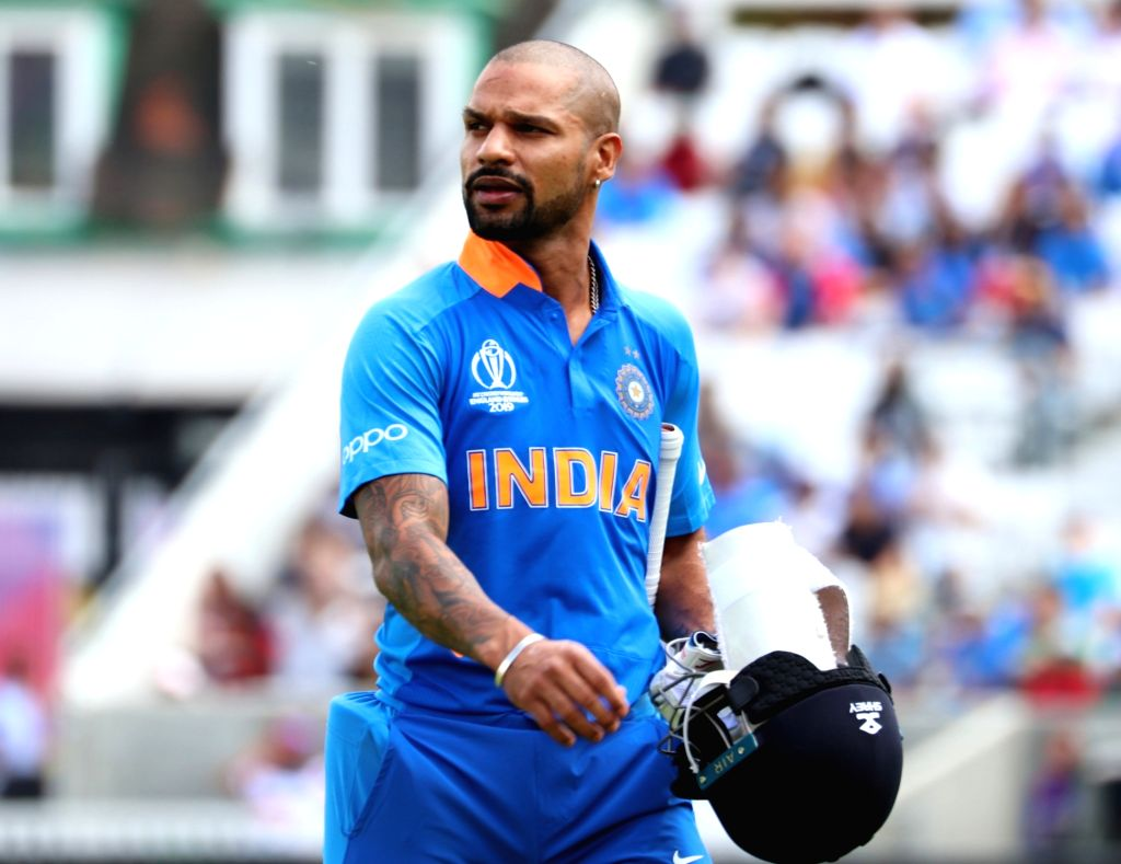India's Shikhar Dhawan walks back to the pavilion after getting dismissed during the first warm-up match between India and New Zealand at the Kennington Oval,  London on May 25, 2019. - Shikhar Dhawan