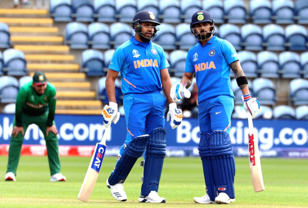 India's skipper Virat Kohli and Rohit Sharma during the second warm-up match between India and Bangladesh at the Sophia Gardens in Cardiff, Wales on May 28, 2019. - Virat Kohli and Rohit Sharma