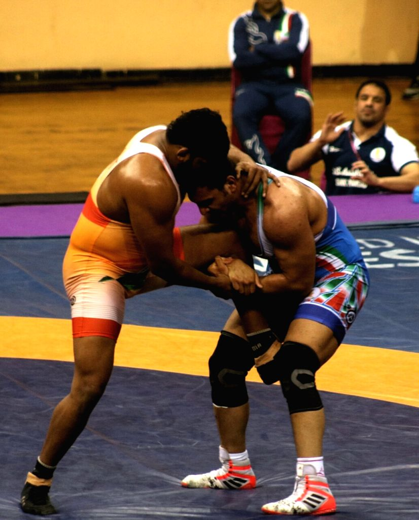 India's Sumit and Yadollah Mohammadkazem Mohebi of Iran in action during Asian Wrestling Championship final in New Delhi on May 14, 2017.