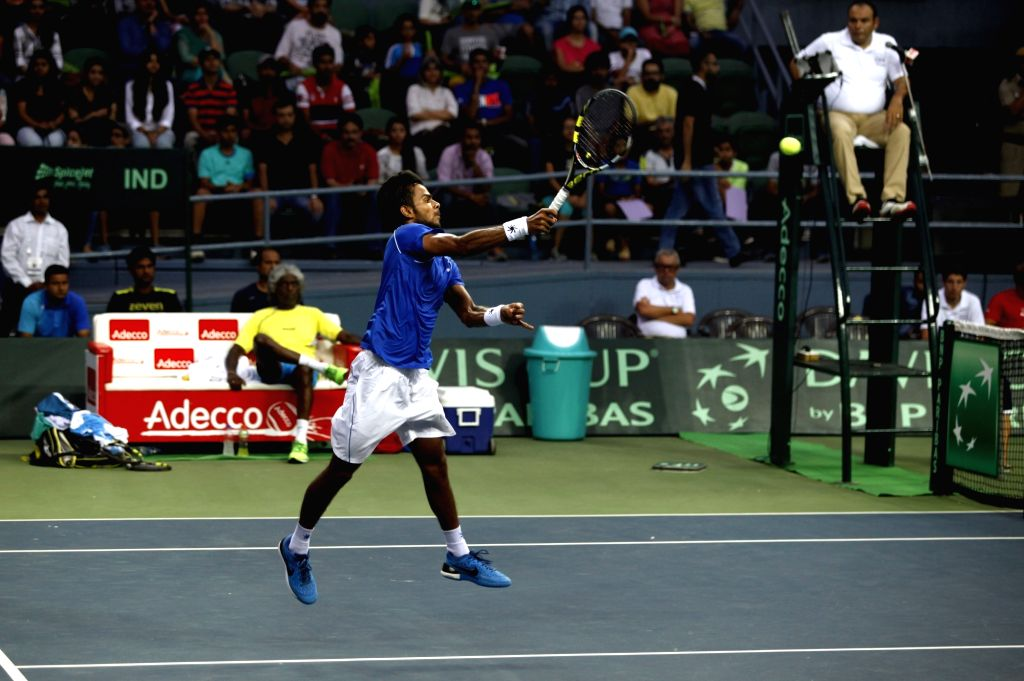 India's Sumit Nagal in action against India's Sumit Nagal during Davis Cup World Group Play-off match at RK Khanna Tennis Stadium in New Delhi on Sept 18, 2016. Spain won.