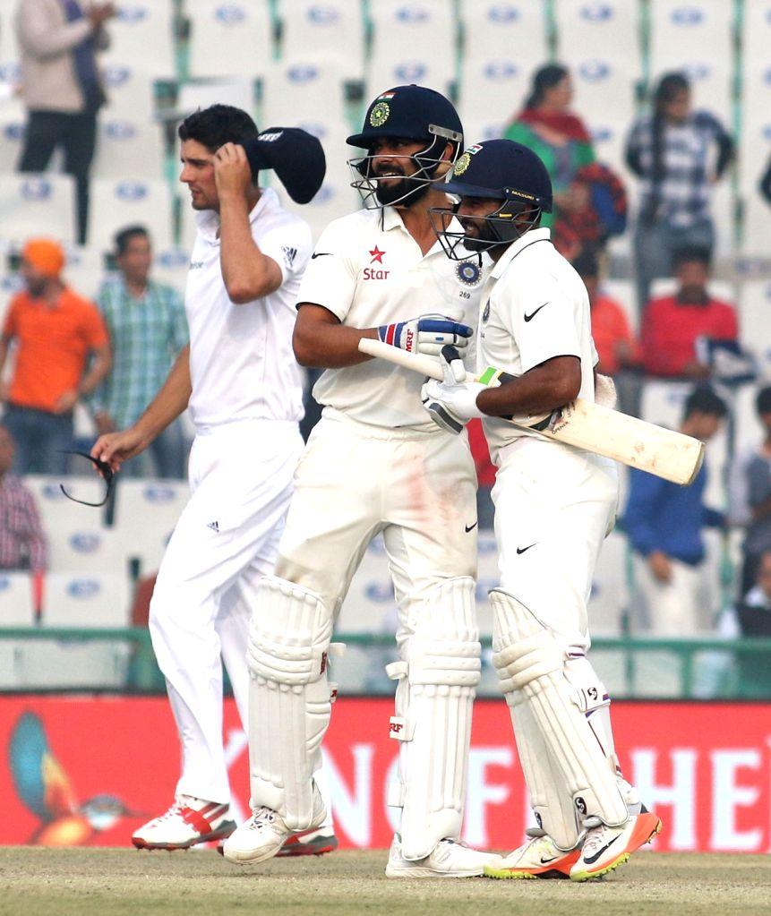 India's Test cricket captain Virat Kohli celebrates after winning the third test match against England at Punjab Cricket Association IS Bindra Stadium, Mohali on Nov 29, 2016. - Virat Kohli