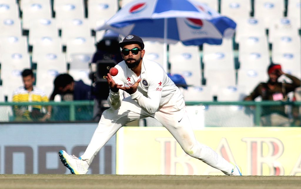 India's Test cricket captain Virat Kohli takes a catch during the third test match between India and England at Punjab Cricket Association IS Bindra Stadium in Mohali on Nov 26, 2016. - Virat Kohli