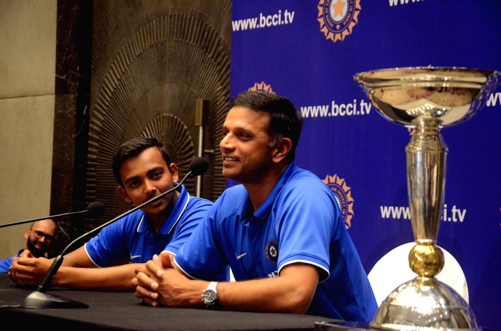 India's U-19 cricket team coach Rahul Dravid with captain Prithvi Shaw addresses during a press conference in Mumbai on Feb 5, 2018. The young heroes thrashed Australia by eight wickets to ... - Prithvi Shaw and Rahul Dravid