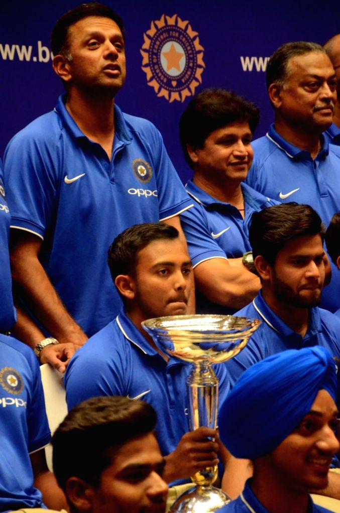 India's U-19 cricket team coach Rahul Dravid with captain Prithvi Shaw and the team during a press conference in Mumbai on Feb 5, 2018. The young heroes thrashed Australia by eight wickets to ... - Prithvi Shaw and Rahul Dravid