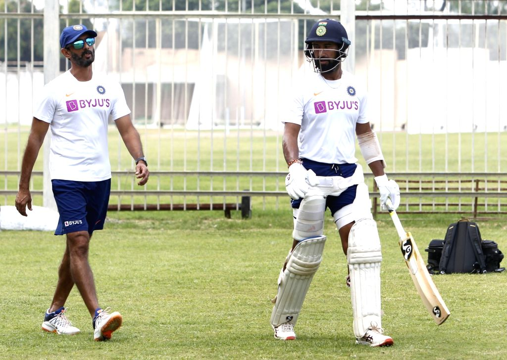 India's Vikram Rathour and Cheteshwar Pujara during a practice session ahead of the 3rd Test match against South Africa at JSCA International Stadium in Ranchi on Oct 17, 2019.