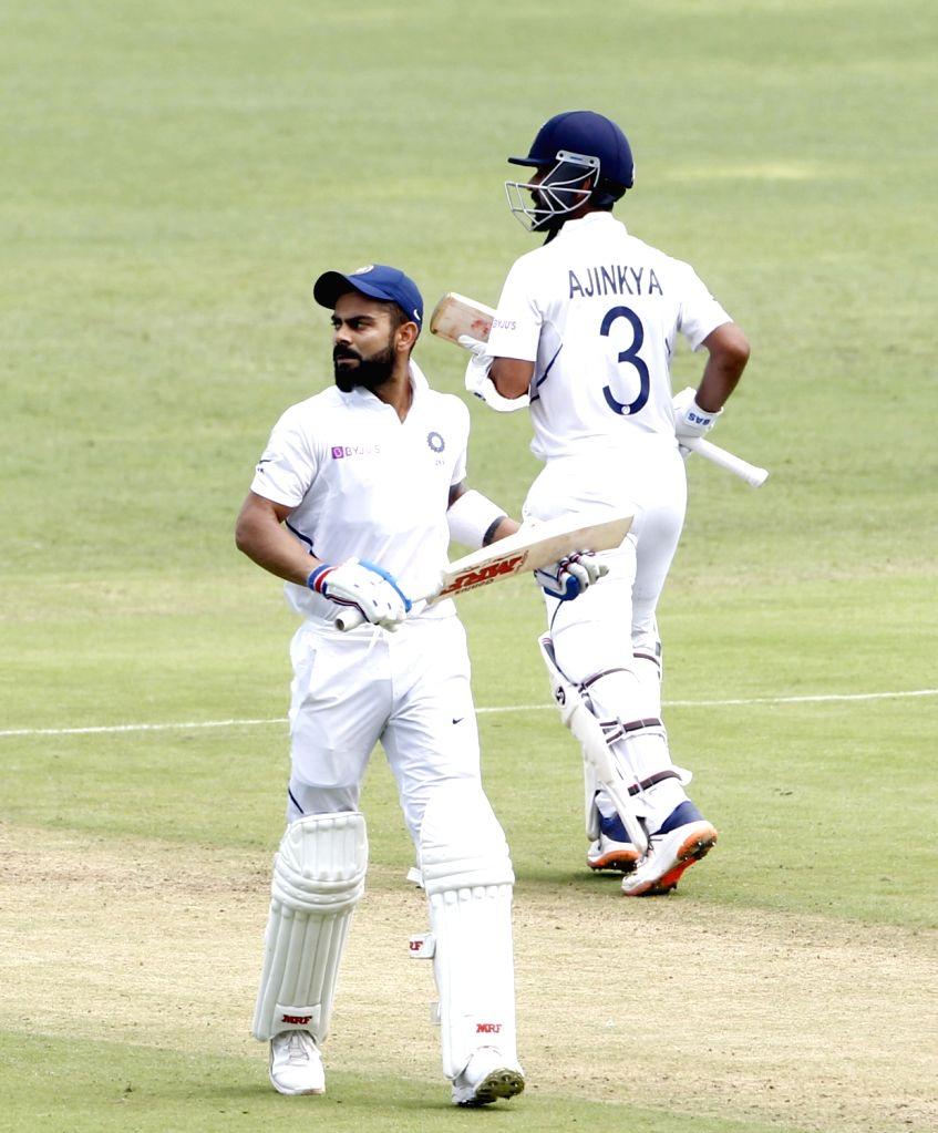 India's Virat Kohli and Ajinkya Rahane on Day 2 of the second Test match between India and South Africa at Maharashtra Cricket Association Stadium in Pune, on Oct 11, 2019. - Virat Kohli