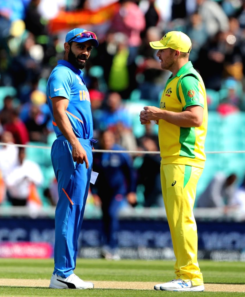 India's Virat Kohli and Australian skipper Aaron Finch during the toss ahead of the match between India and Australia during ICC Cricket World Cup 2019 at the Oval, in Kennington, England ... - Virat Kohli