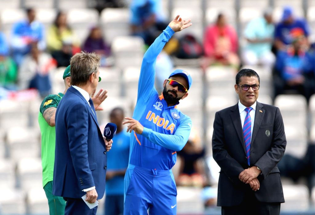 India's Virat Kohli and South Africa's Faf du Plessis during the toss ahead of the 8th match of 2019 World Cup between India and South Africa at The Rose Bowl in Southampton, England on ... - Virat Kohli