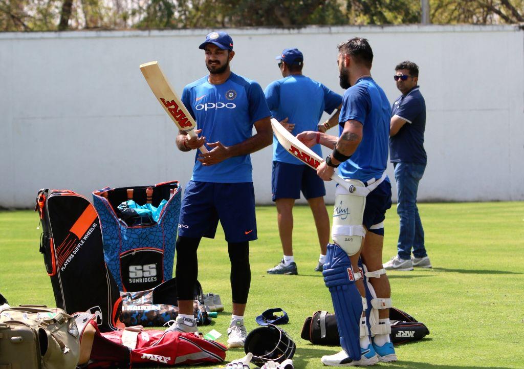 India's Virat Kohli and Vijay Shankar during a practice session ahead of the 2nd ODI match against Australia, at Vidarbha Cricket Association (VCA) Stadium, in Nagpur, on March 4, 2019. - Virat Kohli