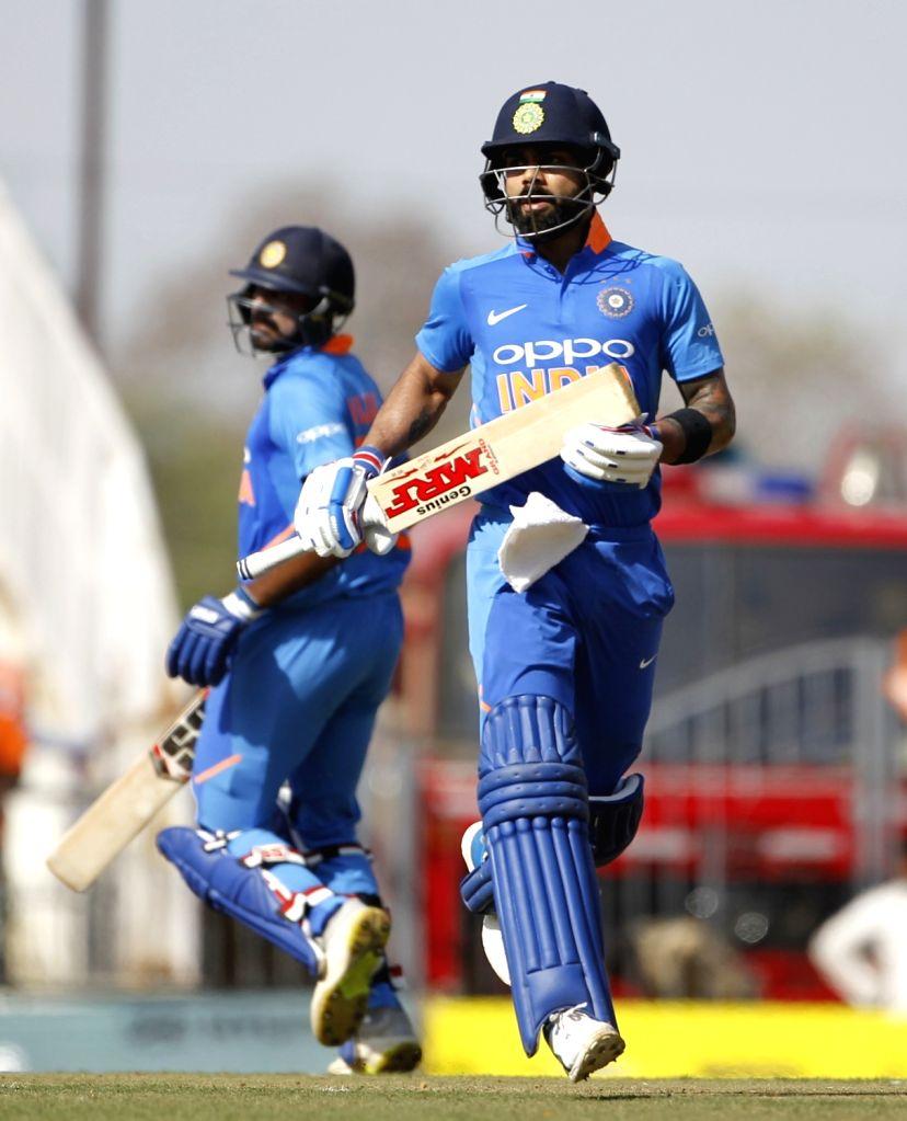 India's Virat Kohli and Vijay Shankar during the second ODI match between India and Australia at Vidarbha Cricket Association (VCA) Stadium, in Nagpur, on March 5, 2019. - Virat Kohli
