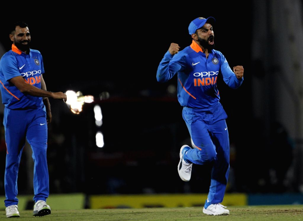 India's Virat Kohli celebrates fall of Peter Handscomb's wicket during the second ODI match between India and Australia at Vidarbha Cricket Association (VCA) Stadium, in Nagpur, on March 5, ... - Virat Kohli