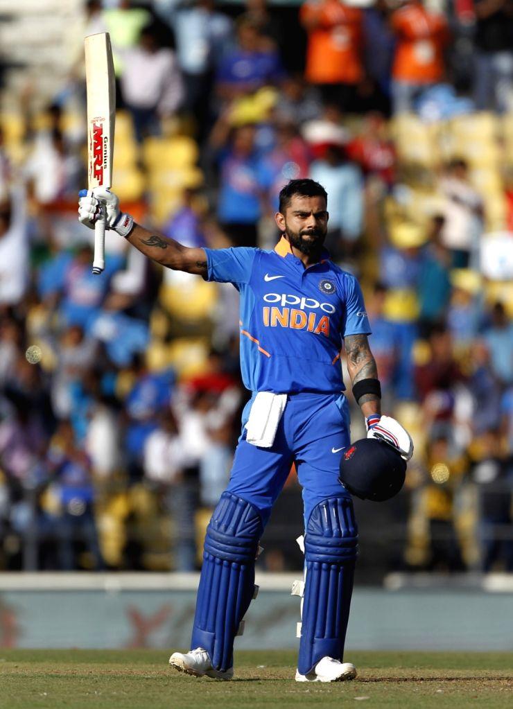 India's Virat Kohli celebrates his century during the second ODI match between India and Australia at Vidarbha Cricket Association (VCA) Stadium, in Nagpur, on March 5, 2019. - Virat Kohli