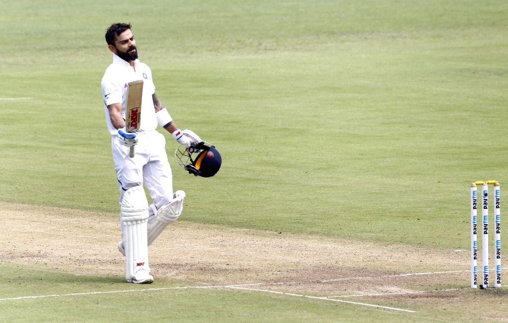 India's Virat Kohli celebrates his century on Day 2 of the second Test match between India and South Africa at Maharashtra Cricket Association Stadium in Pune, on Oct 11, 2019. - Virat Kohli