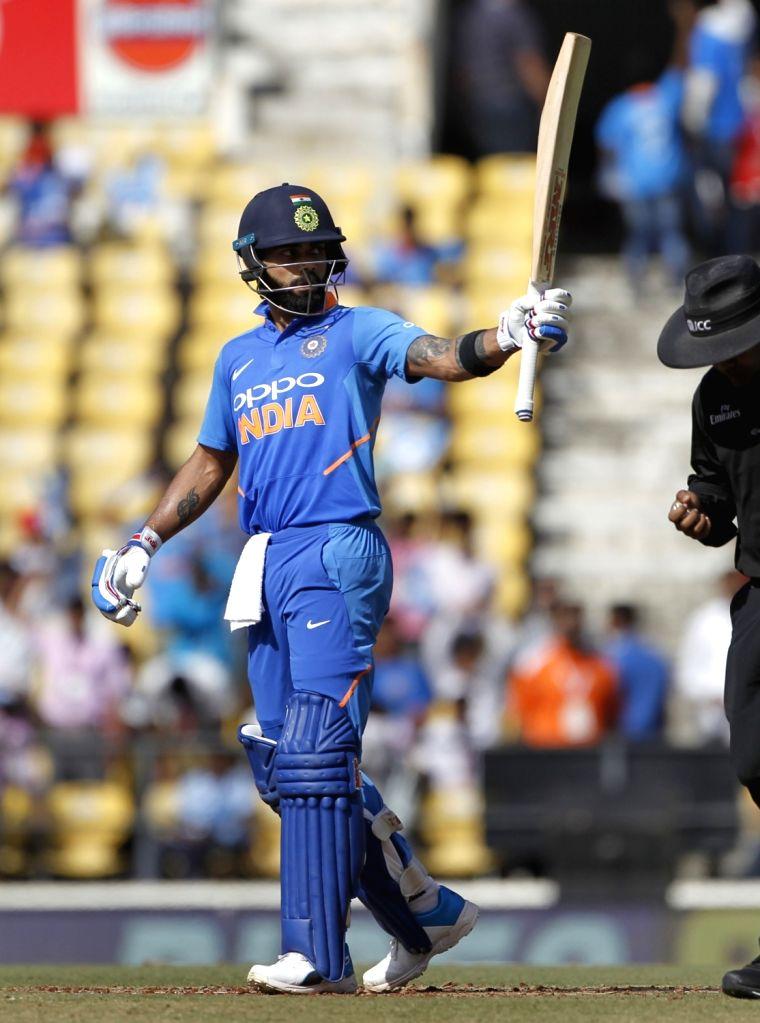 India's Virat Kohli celebrates his half century during the second ODI match between India and Australia at Vidarbha Cricket Association (VCA) Stadium, in Nagpur, on March 5, 2019. - Virat Kohli