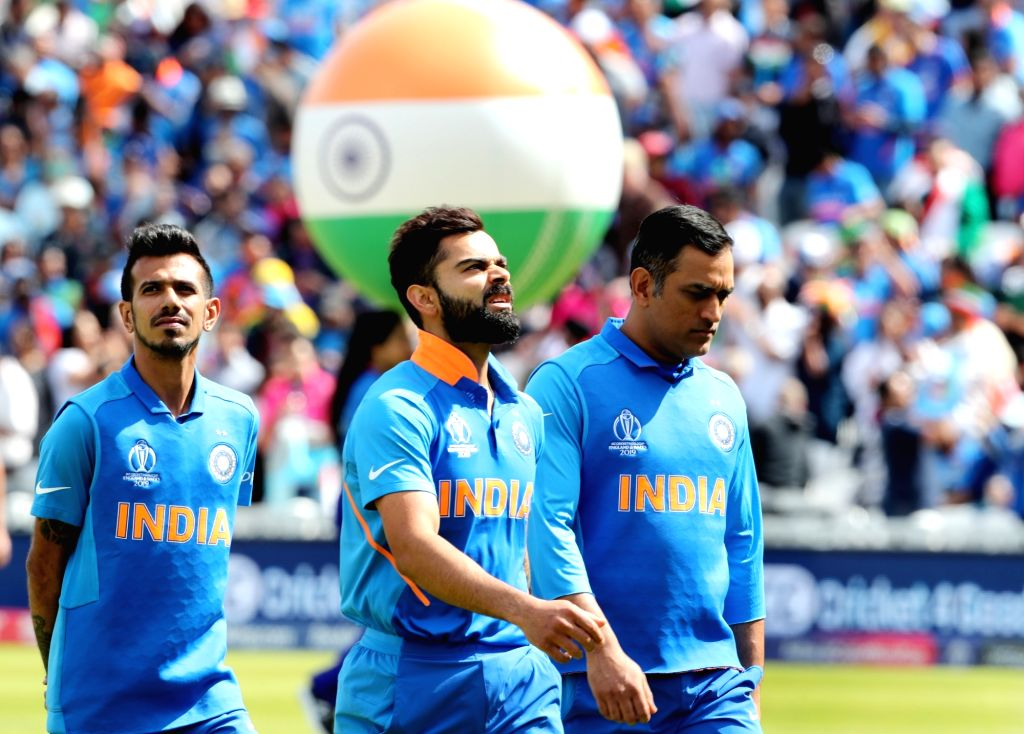 India's Virat Kohli, MS Dhoni and Yuzvendra Chahal ahead of the match between India and Australia during ICC Cricket World Cup 2019 at the Oval, in Kennington, England on June 9, 2019. - MS Dhoni and Virat Kohli