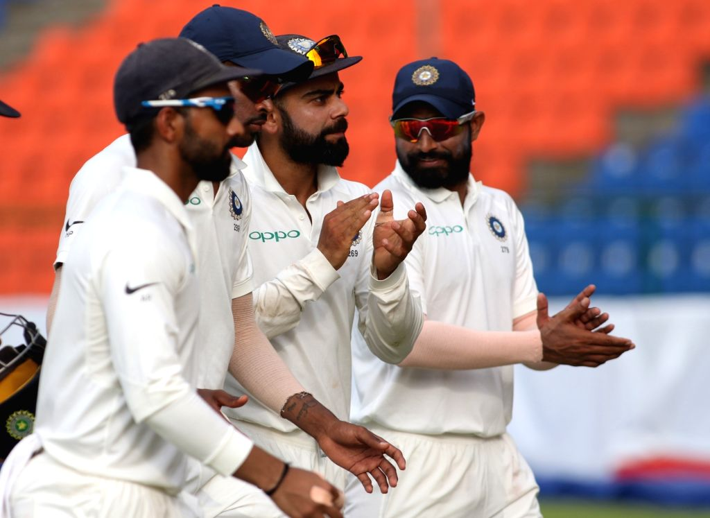 India's Virat Kohli, shares a laugh with teammates  as they leave the ground at the end Day 2 of the third test match between India and Sri Lanka at Pallekele International Cricket Stadium ... - Virat Kohli