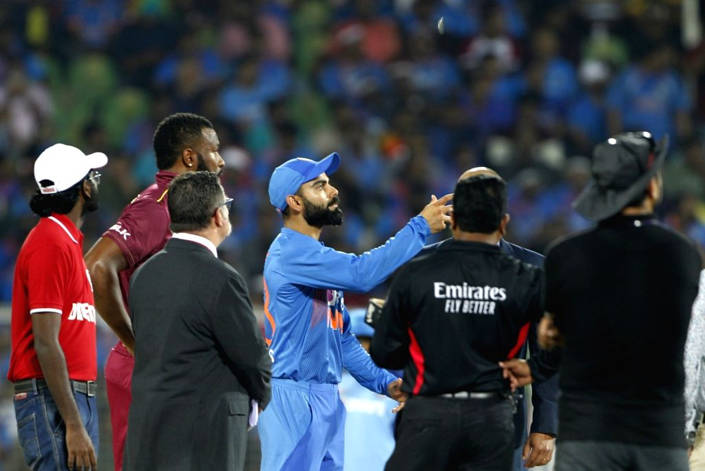 India skipper Virat Kohli and West Indies' skipper Kieron Pollard during the toss ahead of the second T20I match between India and West Indies at the Greenfield International ... - Virat Kohli