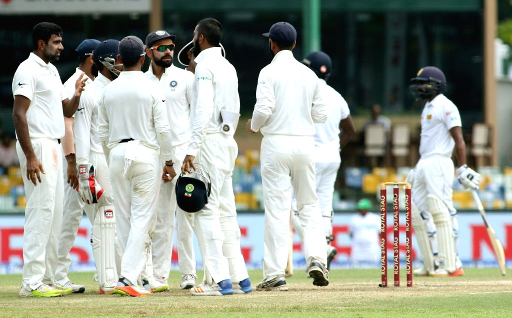 India spinner Ravichandran Ashwin celebrates with teammates the dismissal of Sri Lanka's Angelo Mathews on Day 3 of the second test match between India and Sri Lanka at Sinhalese Sports Club ...