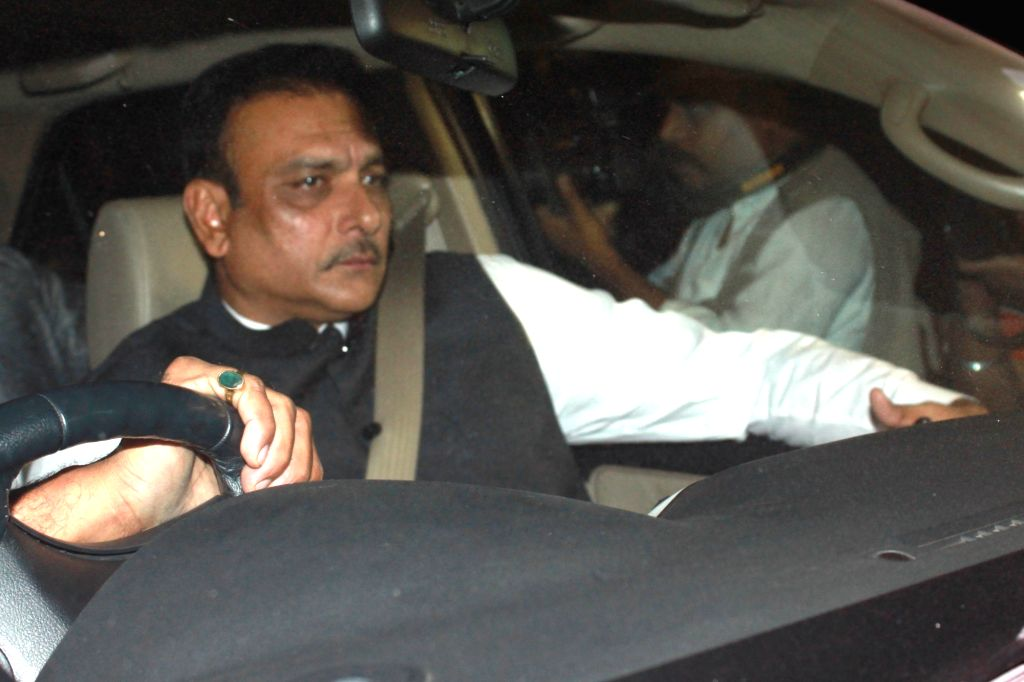 India team director Ravi Shastri arrives to attend the wedding reception of cricketer Harbhajan Singh and actress Geeta Basra in New Delhi, on Nov 1, 2015.