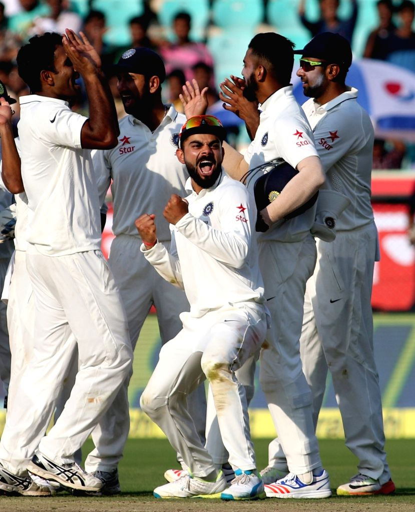 India Test Cricket captain Virat Kohli celebrates fall of a wicket during the Day-2 of the second test cricket match between India and England at the Dr. YS Rajasekhara Reddy ACA-VDCA ... - Virat Kohli and Rajasekhara Reddy A