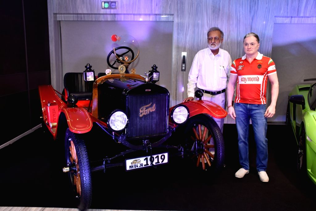 India Vintage and Classic Car Club President Nitin Dossa with Raymond Group Chairman and Managing Director Gautam Singhania during a press conference regarding Parx Super Car Show 2019 in ...