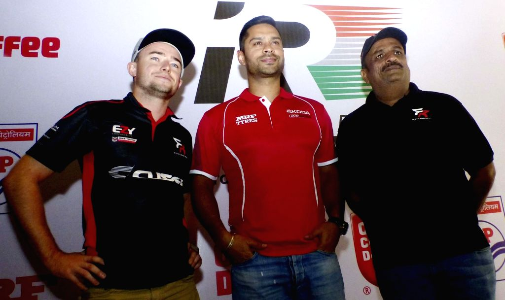 Indian ace rally driver Gaurav Gill (C) during a press conference to announce the Coffee Day Rally in Bengaluru on Nov 29, 2016.