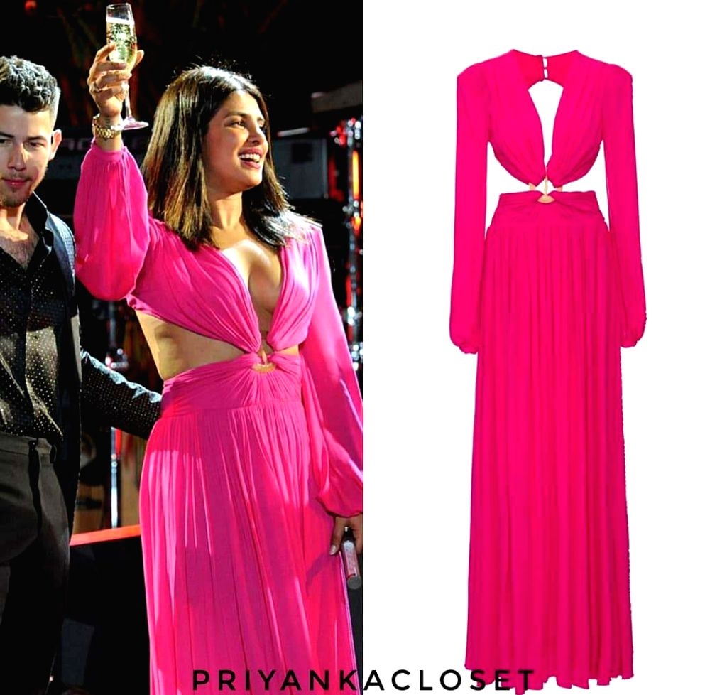 Indian actress Priyanka Chopra Jonas rocked a neon pink cut out gown for New Year's bash which costs over whopping Rs. 60,000. - Priyanka Chopra Jonas