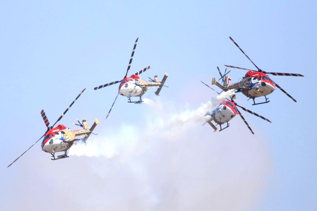 "Indian Air Force's (IAF) Sarang display team enthralls audience at ""Aero India 2019"" - air show at Yelahanka Air Force Station, in Bengaluru, on Feb 20, 2019."