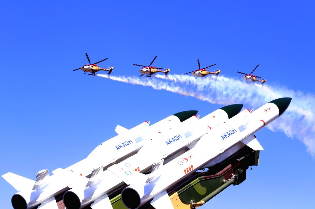 "Indian Air Force's (IAF) Sarang display team enthralls the audience at ""Aero India 2019"" - air show at Yelahanka Air Force Station, in Bengaluru, on Feb 22, 2019."