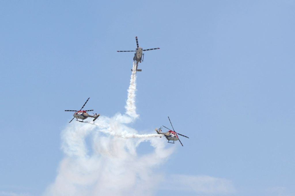 Indian Air Force's Sarang helicopters display maneuvers during an airshow at DefExpo 2018, in Chennai on April 11, 2018.
