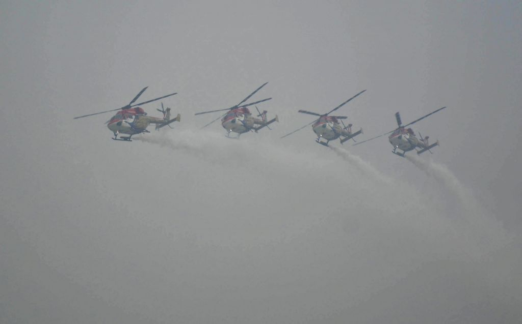 Indian Air forces Sarang helicopter display their aerobatic skills during Full dress rehearsals ahead of Air Force Day at Hindon Air Force base in Ghaziabad on Oct 6, 2016.