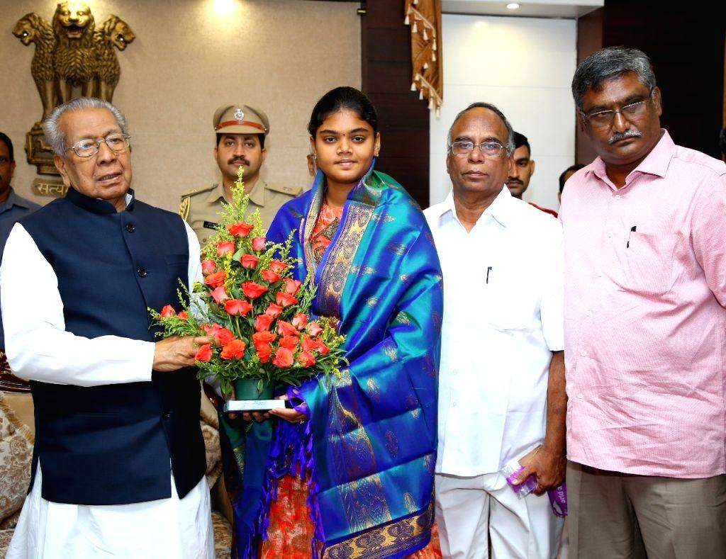 Indian archer Vennam Jyothi Surekha calls on Andhra Pradesh Governor Biswa Bhusan Harichandan in Vijayawada, Sep 14, 2019.
