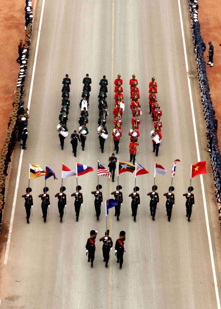 Indian Army Band drawn from 39 Gorkha Training Centre and 1 EME Centre, marching smartly at Rajpath with ASEAN flag and flags of the 10 ASEAN countries during the full dress rehearsal for ...