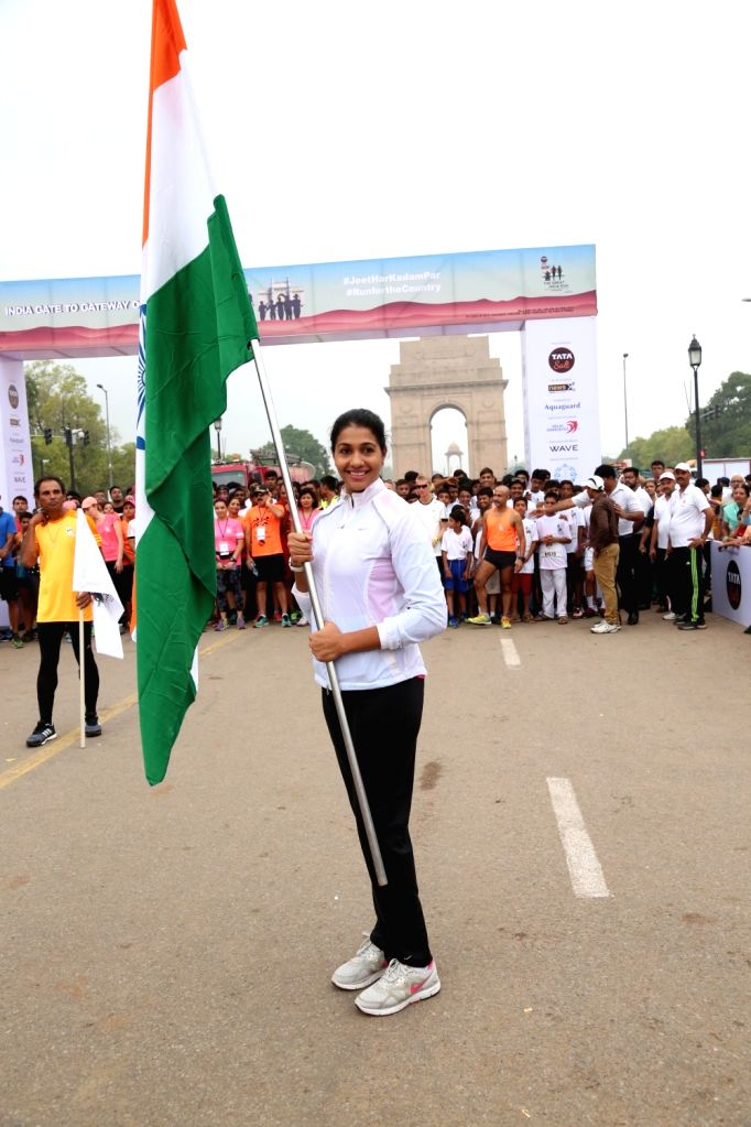Indian athlete Anju Bobby George flagg off the 'Great India Run', India's first multi-city marathon at India Gate in New Delhi on July 17, 2016.