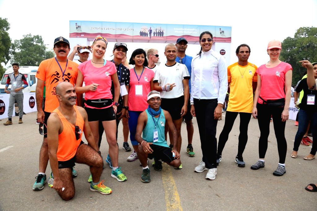 Indian athlete Anju Bobby George with participants during the 'Great India Run', India's first multi-city marathon at India Gate in New Delhi on July 17, 2016.