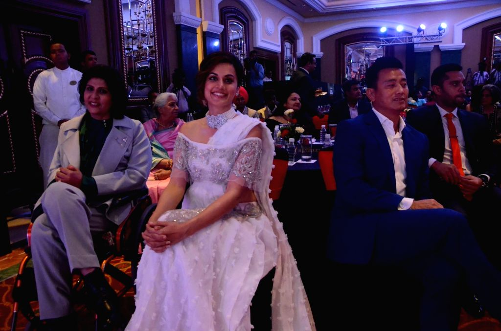 Indian athlete Deepa Malik, actress Taapsee Pannu and former footballer Bhaichung Bhutia during Sports Illustrated award ceremony in Mumbai, on July 6, 2017. - Taapsee Pannu and Malik